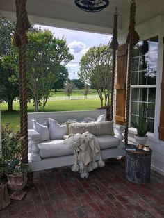 Porch Swing with rope rangers. Farmhouse Porch Swing with rope rangers. Porch Swing with rope rangers #PorchSwingwithroperangers #Farmhouseswing #farmhouseporchswing Beautiful Homes of Instagram @cindimc.ivoryhome