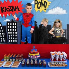 I love the costumes and backdrop for this Super Hero party