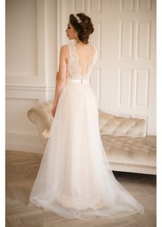 Featuring a delicately laced top with floral appliqué and a plunging illusion neckline, this gorgeous dress also comes with a stunning illusion back with lace appliqué with a sweeping cathedral train, finishing the look for an elegant bride.