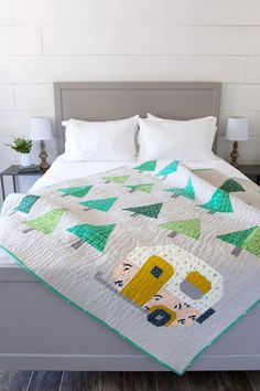 Up North Quilt Pattern | Craftsy  A throw size quilt pattern perfect for the outdoor enthusiast OR for   people, like me, who just think campers and trees are the cutest :) This   entire pattern uses standard piecing and features detailed   instructions,