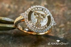 Such a pretty Texas Tech ring! Ladies Double T Halo Ring in Yellow, White, or Rose Gold with Diamonds Graduation Rings College, College Rings, Texas Tech Nursing, School Rings, Radiant Engagement Rings, Or Rose, Rose Gold, Texas Tech Red Raiders, Beautiful Wedding Rings