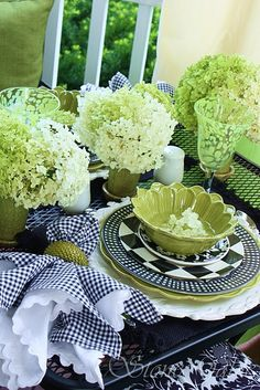 It's so pretty how the green hydrangeas echo the green in the place setting.  It would work well with either black or navy.  |  Stone Gable blog