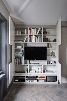 TV Wall Design Idea - Hide Shelves With Large Custom-Made Cabinet Doors