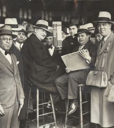 Tim Mara (seated on the left) pictured at the track. Before Mara founded the Giants, he worked as a bookmaker, a profession which was legal in 1925.
