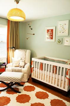 """I adore this color palette. The minty-sage color on the walls is so soothing and sweet. I think the orange is the perfect contrast to add a little life and unexpected """"sassy-ness"""" to this space. The bold pattern in the rug owns me... I feel like the colors will translate nicely to a toddler/kid room."""