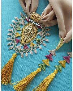 This post was discovered by Ayşe Bilici. Discover (and save!) your own Posts on Unirazi. Crochet Hooded Scarf, Saree Tassels, Point Lace, Passementerie, Scarf Jewelry, Needle Lace, Brick Stitch, Bead Crochet, Beaded Flowers