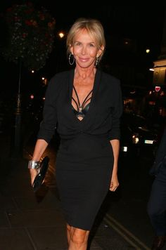 Photo  Trudie Styler still knows how to rock.  In London last week, Sting's wife was spotted heading out of a nightclub wearing a very low V-neck sweater that revealed her sexy, strappy bra.