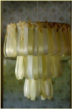 DIY - wedding cake ribbon chandelier, would be just as pretty above the chair in the girls room.