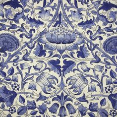 Lodden Fabric A beautiful fabric of scrolling flowers and foliage in china blue on a white background.William Morris has recreated its Lodden fabric which was first created by William Morris between 1882 and 1885. Great care has been taken to maintain the marks and textures of the hand block printed fabric.
