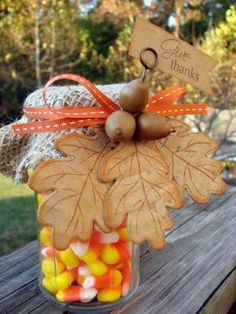 Altered jar by Audrey Pettit -- you can put a mixture of things in the jar and put any decoration around the fabric.