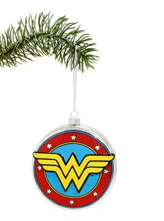 """<div>Tell the truth (no lasso required)... you've been dying for an Amazonian ornament from DC Comics! The Wonder Woman logo and shield are a glittery blown glass warrior's holiday decor dream come true.</div><div><br></div><ul><li style=""""list-style-position: inside !important; list-style-type: disc !important"""">4"""" diameter</li><li style=""""list-style-position: inside !important; list-style-ty..."""