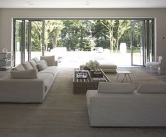 outdoor accordian doors in neutral contemporary living room by mar silver design