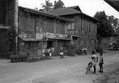 Commercial buildings in provincial towns also serve as homes. Antequera, Bohol Island.