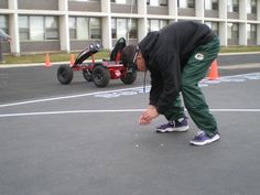 A university student attempts to pick coins up while wearing Drunk Busters Goggles.  It takes 3 times longer to do such a simple task while impaired.   Please do not drink alcohol to the point of impairment and attempt to drive a car, boat, motorcycle, snowmobile, or any other type of vehicle or equipment.