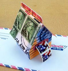 Tutorial on how to make little paper houses. Scrapbook paper, or photo copy stamps onto cardstock Diy And Crafts, Paper Crafts, Paper Toys, Paper Houses, Art Houses, House Template, Postage Stamp Art, Glitter Houses, Handmade Christmas Gifts