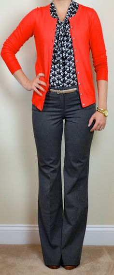 Red cardi, blue polka dot blouse, gray trousers, nude heels/Luccheses.