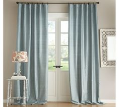Porcelain blue drapes with grey walls