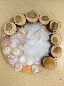 tree blocks, river rocks, feathers and shells