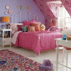 Boring floor? Not anymore.  A bright, colorful garden in full bloom makes this rug an eye-catching addition to a bedroom or playroom. Details, details Hand hooked .