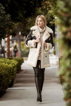 For those who like a little edge, the leather-trimmed shearling is where it's at. Since the statement is in the texture, stick to a basic color.   Biker Sheepskin Coat, Coach $2495 Roll Neck Sweater, The Elder Statesman $1100 Edita Leather Legging, J Brand $948 Stephan Booties, Carvela Kurt Geiger $245 Ballon Bleu de Cartier Watch, Cartier $32100