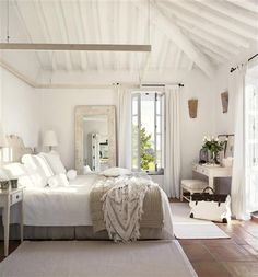 perfect beach house guest bedroom - love the big mirror with the distressed wood frame leaning against the wall