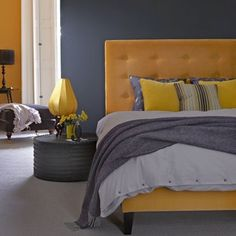 Yellow and Grey  Yellow and grey is a classic colour combination that works particularly well for a bedroom. Adding a small accent in slightly different shade (note the lime green vase) makes it look modern.