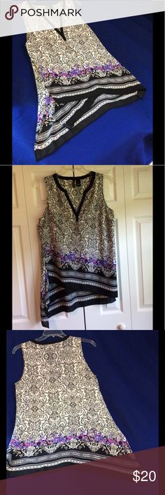 "NEW DIRECTIONS top, women's size L. (New) CLOSET CLUTTER CLEARANCE 😎items must go! Hello POSH friends! Hope you have a blessed day. This is the last markdown before removing from my closet.........NEW DIRECTIONS top, women's size L.  Measurements are 21"" across the bust & approximately 32"" long, in center. The fit seems to be close to XL. The purple & blue flowers give it a special pop of color.  New w/o tags. No flaws to note. Thanks for shopping my closet. NEW DIRECTIONS Tops"