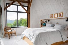 Architecture studio La Firme, have completed the modern restoration of a 100 year old barn in Quebec, Canada. Mechanical Room, White Staircase, White Oak Floors, Green Cabinets, Shed Homes, Cabin Homes, Log Homes, Wood Beams, Large Windows