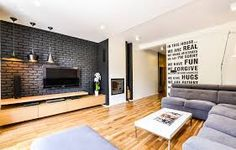 black brick wall / Interior Metamorphosis by Disenio Interior Design Images, White Interior Design, Interior Styling, Interior And Exterior, Black Brick Wall, Black And White Interior, Wall Cladding, Living Room Interior, Interiores Design
