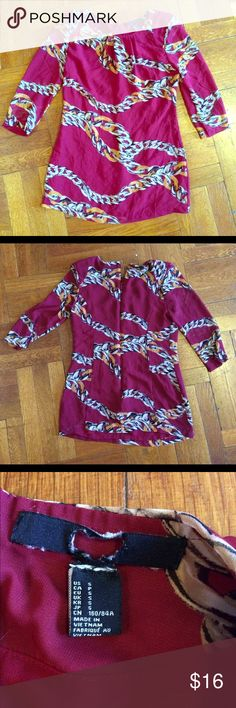Design Print Blouse Maroon, silver, gold chain print blouse. 3 quarter sleeves. Maroon material under the sheer patterned top. Zip in the back for form fitting. Size small. Offers accepted. Tops Blouses