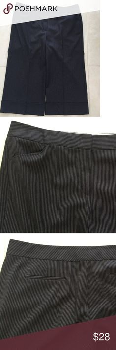 Tahari Pinstripe Cuffed Culottes Pants Black White Pinstripe Cuffed Culottes   Zip Fly Front with Double Hook and Bar Closure  2 Front Pockets  2 Rear Welt Pockets   Waist 36, Hips 44 and Inseam 21  Front Rise 10 and Rear Rise 16                                                                          65% Polyester, 33% Rayon and 2% Elastane  Dry Clean   Please let me know if you have any questions.  Thank you for looking!!!!!!! Tahari Pants Capris