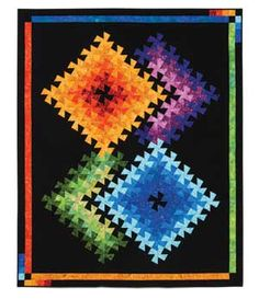TWISTER ILLUSIONS QUILT KIT  like this!! colors really pop against the black.