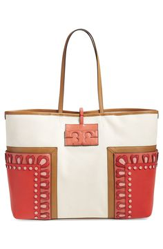 Contemporary and refined, this minimal Tory Burch tote crafted from natural canvas and bold leather panels is perfect for both everyday use and weekend travel.