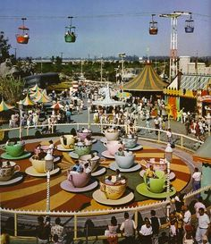 """Mad Tea Party. The """"Tea Cups"""" as they are commonly called were originally located where King Arthur Carrousel is today. They were moved closer to Alice in Wonderland in the 1983 New Fantasyland."""