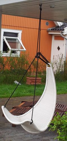 DIY: IKEA Hackers: A garden swing. I love how they used this indoor swing outdoors for a beautiful look.