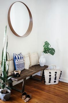 Bohemian style entryway with bench, pillows, plants and mirror