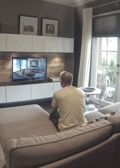 Besta white tv unit, Kivik beige sofa, and Strind coffee table. I love the wood planking behind the TV!