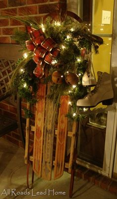 Holiday porch decor ~~ vintage sled with lights and vintage skates