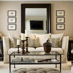 Toronto Interior Design Group - living rooms - mushroom, grasscloth, wallpaper, accent wall, gray, walls, espresso, stained, beveled, mirror, off-white, slipcover, sofa, ebony, end tables, black, cane, chairs, striped, cushions, art, gray, tufted, ottoman, bench,