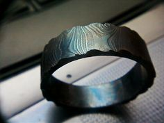 damascus steel ring size  13. $75.00, via Etsy.
