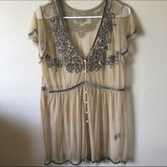 BKE buckle tunic top Bke BUCKLE Embellished/beaded all around  I remember buying Size M (however on tag it does not show size and it fit me a little loose, so can be like a M/L) Only worn once  Has missing button in the middle/center where the beading joins. Didn't notice when I bought it that it was missing a button.  I put a safety pin in and you can't tell its missing. See pictures.  All in great condition other than the missing button.  Hard for me to let go but I have only worn once…