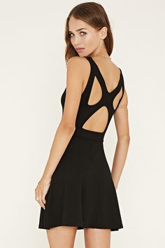 A sleeveless dress crafted from textured knit in a fit and flare silhouette with a V-neckline, a crisscross cutout back, and a mini length.