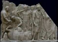 Men in engaged in a ritual sacrifice in front of the temple of the Capitoline Jupiter, Roman relief (marble), 2nd century AD, (Musée du Louvre, Paris).