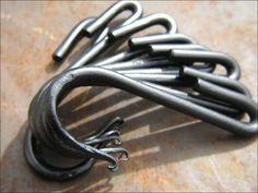Set of 8 Hand Forged Iron Pot Rack Hooks by VinTin. $37.00, via Etsy.