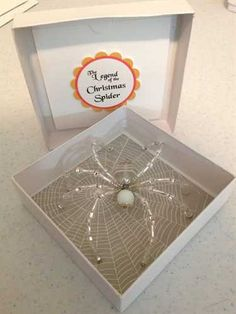 ShopHandmade - Beaded Christmas Spider / Window Ornament - Silver & White