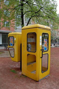 Yellow phone booths, Eisenhüttenstadt, Fuerstenberg, Brandenburg, Germany, 2009, photograph by Olga Schlyter.