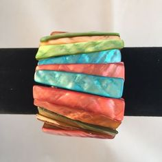 "Multi-color orange, green, red and turquoise rectangular pieces of dyed mother of pearl stretch bracelet.  Measures 1.75"" wide.  Pre-owned. Excellent condition.  Free shipping. Ships within 3 business days within the US only via USPS First Class mail."