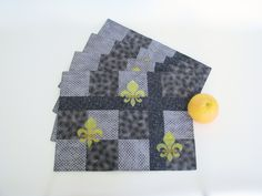 gray pieced placemats, set of 4 handpainted fleur-de-lis design, reversible table linens, black and white, upcycled handmade grey placemats by ThreadandWoodCrafts on Etsy