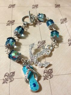 Items similar to Nautical anchor bracelet- aqua blue Czech bead bracelet- flip flop beach jewelry on Etsy Beach Jewelry, Unique Jewelry, Nautical Outfits, Beach Flip Flops, Nautical Anchor, Aqua Blue, Beaded Bracelets, Beads, Trending Outfits