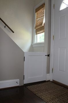 DIY dog gate with cat door for boss or basement doorway